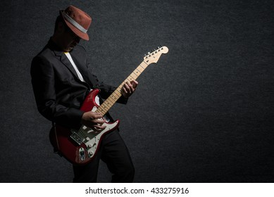 music concept, guitarist in dark