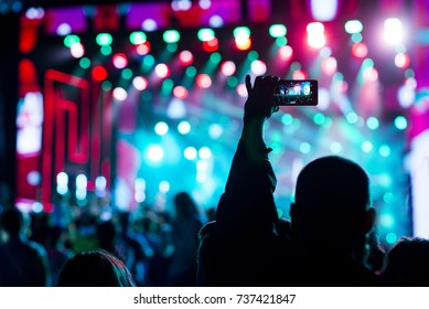 Music concert, silhouette of girls hands raised up, enjoying music in the club, luxury night performance, active lifestyle, having fun. Concert background.