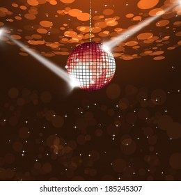 music disco ball on dark red background with blurry lights