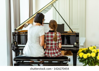 Music. Education. Lesson in music school. Teacher and pupil. Music lesson at the piano