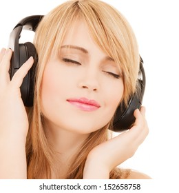 music and entertainment concept - happy girl with headphones