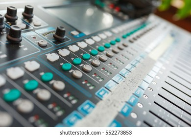 Music equipment closeup. Management console sound design at the event. Big black mixer with control knobs.