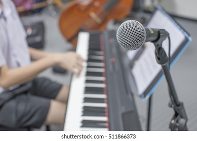 music equipment,microphone and piano player