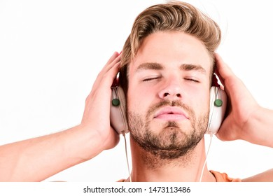 Music fan concept. It is great time to be creating new realities. Man handsome bearded guy listening music headphones white background. Audiovisual spectacular. Melody put over various types of music.