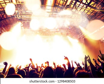 Music festival crowd in front of a stage