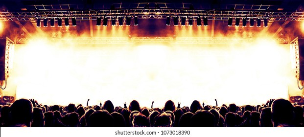 Music festival venue with fans clapping