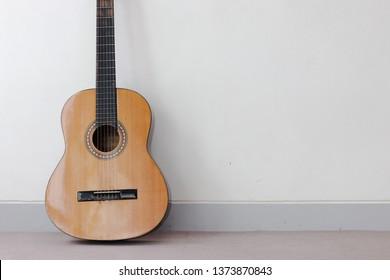 Music Instrument  Guitar on White back ground, Wood Guitar, Gold Guitar, Wood GT, Gold GT. Music instrument copy Space, Music instrument mock up. Guitar mock up, Music background