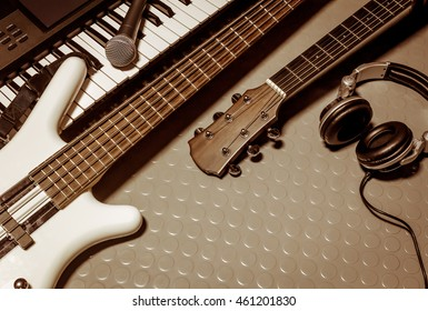 music instruments band the  classic guitar,microphone,headphones,electronic piano bass on floor background with copy space.