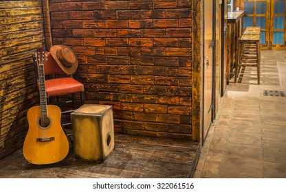 Music instruments on wooden stage in pub