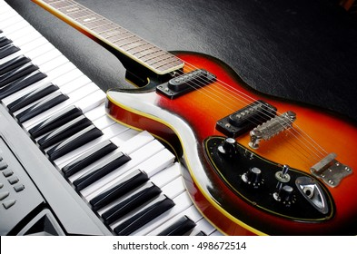 Music keyboard and electric guitar.