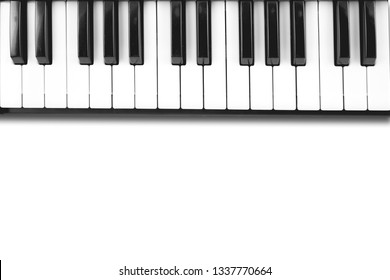 music keyboard keys close up in white background with text space.