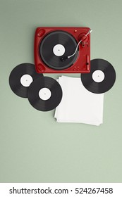 Music lover vintage turntable with vinyl and coffee latte art on color background