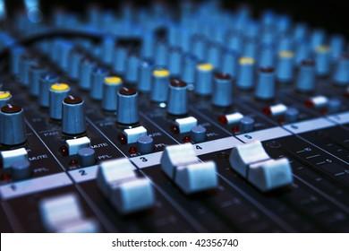 Music mixer desk in darkness. Dj mix club.