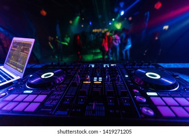 music mixer DJ controller Board for professional mixing of electronic music in a nightclub at a party