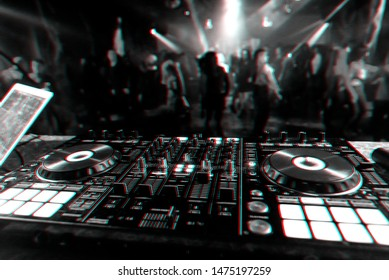music mixer DJ controller Board for professional mixing of electronic music in a nightclub at a party. Black and white photo with glitch effect and small grain