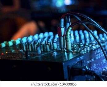 Music Mixer at nightclub with connected wires