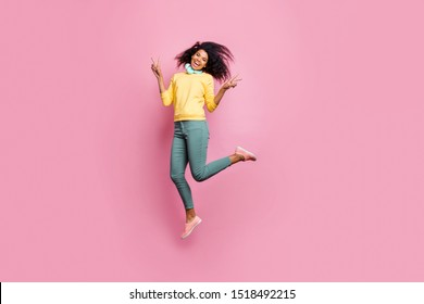 Music is my hobby and life style concept. Full length photo of pretty carefree dreamy lovely nice super feminine teenager making v-sign jumping up isolated pastel color background