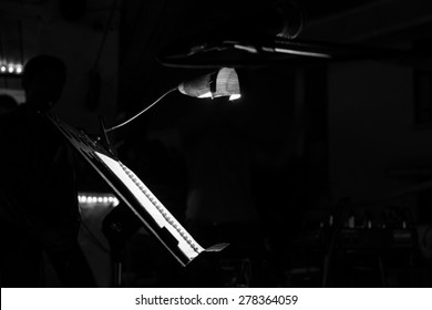 Music note stand with a lighting bulb in a cafe (Black and white tone)
