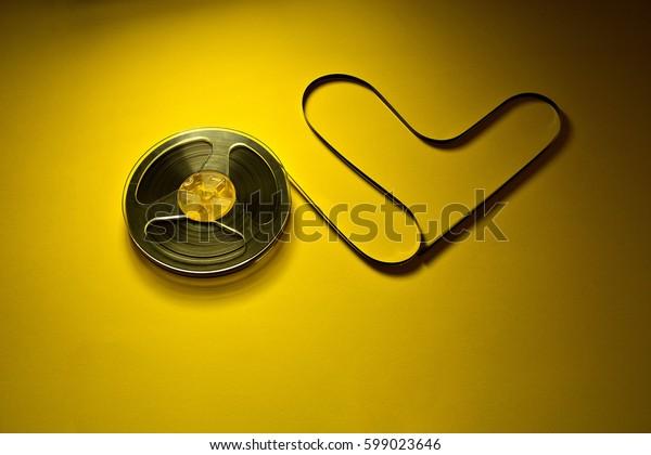 music on Bobbin cassette on yellow background