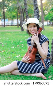 Music people photo : Portrait of young healthy girl play ukulele guitar