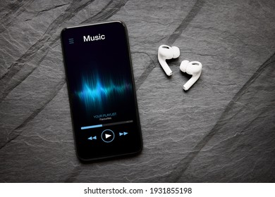 Music player on mobile phone and wireless earbuds