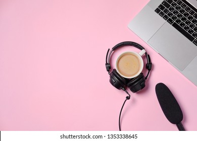 Music or podcast background with headphones, microphone, coffee and laptop on pink table, flat lay. Top view, flat lay
