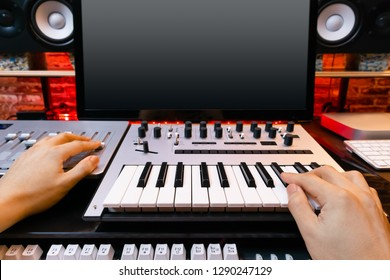 music producer hands arranging a song in sound studio. recording concept