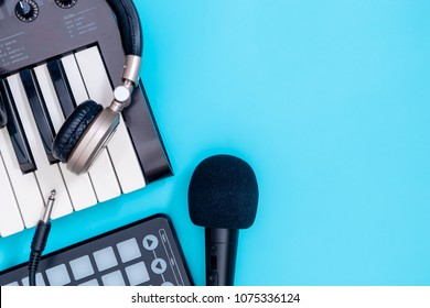 Music recording technology equipment with keyboard headphone and microphone on blue copy space for Home Music Making concept poster and Banner.