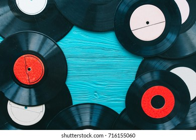 music records and notes on wooden background