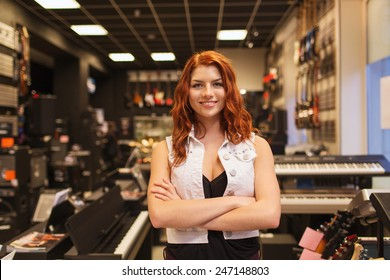 music, sale, people, musical instruments and entertainment concept - smiling female assistant or customer at music store