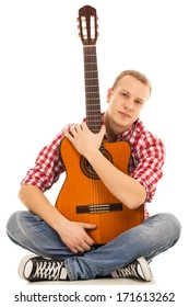 Music, sound. Musician with a guitar on white background