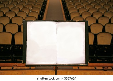 music stand with empty white paper in a theater,auditorium or opera