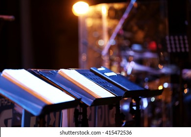 Music stands with notes on stage at concert