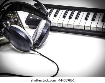 Music stuff headphone keyboard and mixer and blank space for text