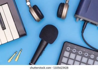 Music Sutdio recording equipment on blue surface