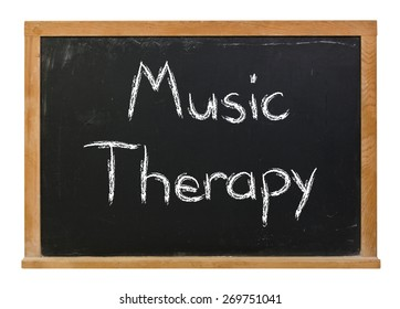 Music Therapy written in white chalk on a black chalkboard isolated on white
