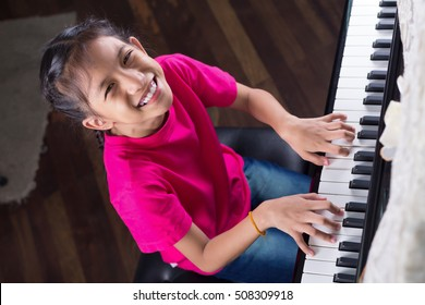 Music therapy,smiling girl playing piano