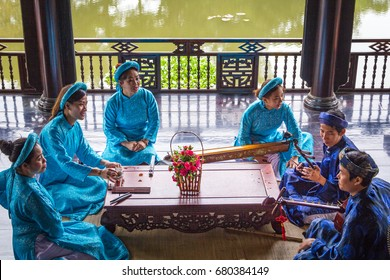 Music traditional band Vietnam/Hue, Vietnam – March 15 2016: These people wear traditional clothes, playing traditional musical instrument in Hue, Vietnam