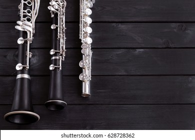 Musical background, poster - oboe, clarinet, flute, symphony orchestra. Musical still life. Free space for text.