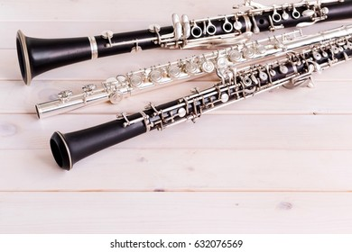 Musical background, poster - oboe, clarinet, flute, rose, symphony orchestra. Morning musician, still life.