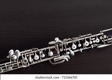 Musical background, poster - oboe on black background. Free space for text.