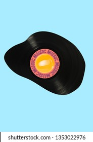 Musical breakfest. Alternative view of food and snack. Delicious music taste. Fried egg or omelette formed vynil record. Negative space to insert your text. Modern design. Contemporary art collage.
