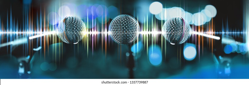 Musical design,Karaoke concept.Microphone and sound waves.Live music and blurred stage lights. Music background