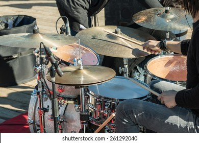 musical drums: hands with wooden sticks