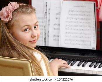 Musical education: cute girl playing the piano