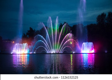 Musical fountain with colorful illuminations at night. Ukraine, Vinnitsa