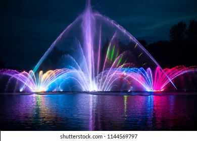 Musical fountain with colorful illuminations in night. Vinnitsa, Ukraine