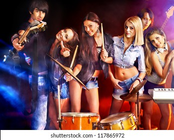 Musical group performance in night club. Lighting effects.