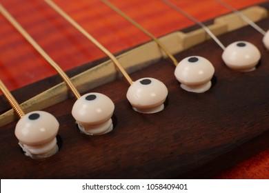 Musical instrument - bridge pin vintage acoustic guitar.