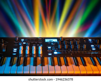 Musical instrument electronic synthesizer on a background of colored rays. Background on the theme of music, disco and synthesizer games.